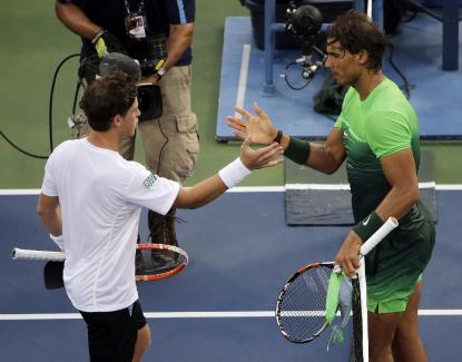 Diego Schwartzman, of Argentina, left, greets Rafael Nadal, of Spain, after Nadal won their second round match of the U.S. Open tennis tournament, Wednesday, Sept. 2, 2015, in New York. (AP Photo/Matt Rourke)