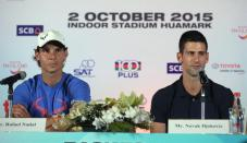 Rafael Nadal of Spain, left, and Novak Djokovic of Serbia right, attend a press conference for their exhibition tennis match in Bangkok, Thailand, Thursday, Oct. 1, 2015. The match will be held on Oct. 2 .(AP Photo/Sakchai Lalit)