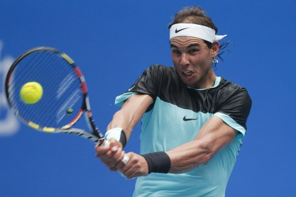 Rafael Nadal of Spain returns a shot against Wu Di of China during the Men's singles first round match on day four of the 2015 China Open at the China National Tennis Centre on October 6, 2015 in Beijing, China. (Oct. 5, 2015 - Source: Lintao Zhang/Getty Images AsiaPac)