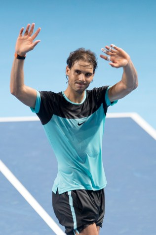 Spain's Rafael Nadal cheers after winning his semifinal match against France's Richard Gasquet at the Swiss Indoors tennis tournament at the St. Jakobshalle in Basel, Switzerland, Saturday, Oct. 31, 2015. (Georgios Kefalas/Keystone via AP)