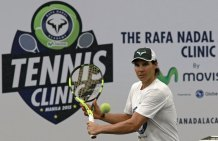 Tennis player Rafael Nadal return a ball after a sports clinic hosted by him at the Colegio De San Agustin in Makati city, metro Manila December 6, 2015. REUTERS/Romeo Ranoco
