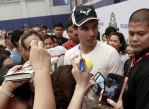 Fans of tennis player Rafael Nadal gather for his autograph after a sports clinic hosted by him at the Colegio De San Agustin in Makati city, metro Manila December 6, 2015. REUTERS/Romeo Ranoco