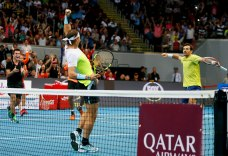 Spain's Rafael Nadal, foreground, of the Indian Aces celebrates a point with teammate Ivan Dodig, right, of Croatia during the men's doubles match against Philippine Mavericks' Richard Gasquet and Edouard Roger-Vasselin of France in the 2015 International Premier Tennis League Tuesday, Dec. 8, 2015 at the Mall of Asia Arena at suburban Pasay city south of Manila, Philippines. The Indian Aces won. (AP Photo/Bullit Marquez)