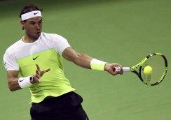 Rafael Nadal of Spain returns the ball to Andrey Kuznetsov of Russia during their Qatar Open men's single tennis match in Doha, Qatar January 7, 2016. REUTERS/Ibraheem Al Omari