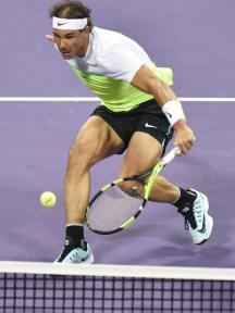 Rafael Nadal of Spain in action against Novak Djokovic of Serbia during their final match of the Qatar ATP Open Tennis tournament at Khalifa Tennis Complex in Doha, Qatar, 09 January 2016. (España, Tenis) EFE/EPA