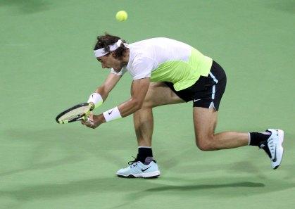 Rafael Nadal of Spain returns the ball to Novak Djokovic of Serbia during their Qatar Open men's single tennis final match in Doha, Qatar, January 9, 2016. REUTERS/Naseem Zeitoon