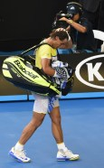 Spain's Rafael Nadal gestures as he leaves the court after defeat in his men's singles match against compatriot Fernando Verdasco on day two of the 2016 Australian Open tennis tournament in Melbourne on January 19, 2016. AFP PHOTO / WILLIAM WEST-- IMAGE RESTRICTED TO EDITORIAL USE - STRICTLY NO COMMERCIAL USE