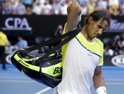Rafael Nadal of Spain packs his bags as he leaves Rod Laver Arena following his loss to compatriot Fernando Verdasco in their first round match at the Australian Open tennis championships in Melbourne, Australia, Tuesday, Jan. 19, 2016.(AP Photo/Mark Baker)