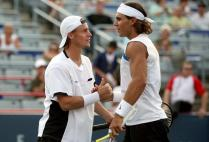 MONTREAL - AUGUST 07: Lleyton Hewitt of Australia and Rafael Nadal of Spain (R) celebrate match point against Philip Bester and Pierre-Ludovic Duclos of Canada during the Coupe Rogers August 7, 2007 at Stade Uniprix in Montreal, Quebec, Canada. (Photo by Matthew Stockman/Getty Images)