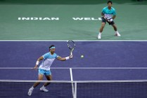 Rafael Nadal and Fernando Verdasco of Spain in action in their doubles match against Bob and Mike Bryan of USA during day six of the BNP Paribas Open at Indian Wells Tennis Garden on March 12, 2016 in Indian Wells, California. (March 11, 2016 - Source: Julian Finney/Getty Images North America)