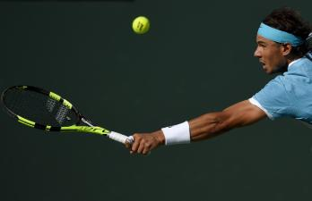 Rafael Nadal, of Spain, reaches to return to Fernando Verdasco, of Spain, during the BNP Paribas Open tennis tournament, Tuesday, March 15, 2016, in Indian Wells, Calif. (AP Photo/Mark J. Terrill)