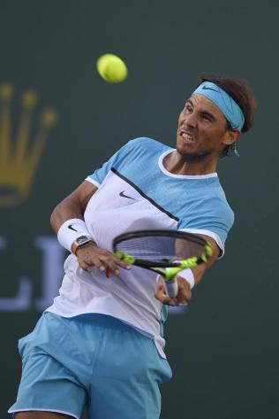 Rafael Nadal, of Spain, hits a ball into the stands after defeating Fernando Verdasco, of Spain, during the BNP Paribas Open tennis tournament, Tuesday, March 15, 2016, in Indian Wells, Calif. (AP Photo/Mark J. Terrill)