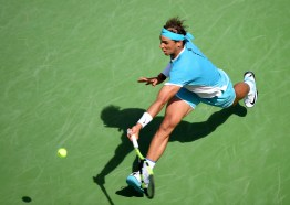 INDIAN WELLS, CA - MARCH 19: Rafael Nadal of Spain hits a running forehand in his loss to Novak Djokovic of Serbia during day thirteen of the 2016 BNP Parisbas Open at Indian Wells Tennis Garden on March 19, 2016 in Indian Wells, California. (Photo by Harry How/Getty Images)