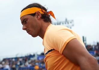 BARCELONA, SPAIN - APRIL 22: Rafael Nadal of Spain looks on in his match against Fabio Fognini of Italy during day five of the Barcelona Open Banc Sabadell at the Real Club de Tenis Barcelona on April 22, 2016 in Barcelona, Spain. (Photo by Manuel Queimadelos Alonso/Getty Images)