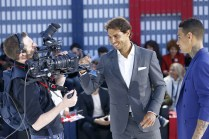 PARIS, FRANCE - MAY 18: Rafael Nadal signs his autograph for the TV camera during the Tommy Hilfiger Hosts Tommy X Nadal Party - Tennis Soccer Match on May 18, 2016 in Paris, France. (Photo by Rindoff Petroff/Hekimian/Getty Images for Tommy Hilfiger)