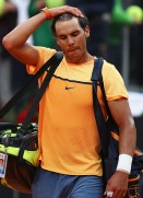 ROME, ITALY - MAY 13: Rafa Nadal of Spain looks on, after losing his match against Novak Djokovic of Serbia during day six of the The Internazionali BNL d'Italia 2016 on May 13, 2016 in Rome, Italy. (Photo by Matthew Lewis/Getty Images)