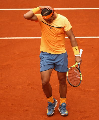MADRID, SPAIN - MAY 07: Rafael Nadal of Spain shows his dejection against Andy Murray of Great Britain in their semi final match during day eight of the Mutua Madrid Open tennis tournament at the Caja Magica on May 07, 2016 in Madrid,Spain. (Photo by Clive Brunskill/Getty Images)