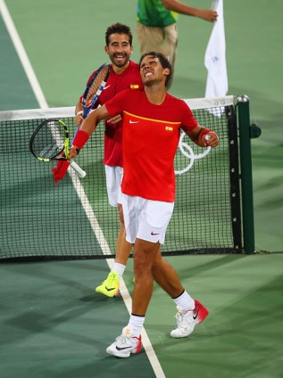 RIO DE JANEIRO, BRAZIL - AUGUST 08: Rafael Nadal and Marc Lopez of Spain celebrate victory during the Men's Doubles second round match on against Juan Martin Del Potro and Maximo Gonzalez of Argentina Day 3 of the Rio 2016 Olympic Games at the Olympic Tennis Centre on August 8, 2016 in Rio de Janeiro, Brazil. (Photo by Clive Brunskill/Getty Images)