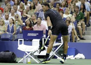 Rafael Nadal, of Spain, runs into the chair of Andreas Seppi, of Italy, while winning the first set of their match at the U.S. Open tennis tournament, Wednesday, Aug. 31, 2016, in New York. (AP Photo/Julio Cortez)