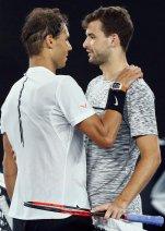 Tennis - Australian Open - Melbourne Park, Melbourne, Australia - early 28/1/17 Spain's Rafael Nadal consoles Bulgaria's Grigor Dimitrov after winning his Men's singles semi-final match. REUTERS/Thomas Peter