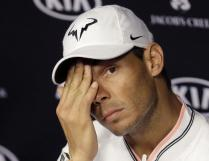 Spain's Rafael Nadal answers a question during a press conference ahead of the Australian Open tennis championships in Melbourne, Australia, Sunday, Jan. 15, 2017. (AP Photo/Dita Alangkara)