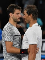 Spain's Rafael Nadal (R) speaks with Bulgaria's Grigor Dimitrov after Nadal's victory in their men's singles semi-final match on day 12 of the Australian Open tennis tournament in Melbourne on January 28, 2017. / AFP / Greg Wood / IMAGE RESTRICTED TO EDITORIAL USE - STRICTLY NO COMMERCIAL USE (Jan. 26, 2017 - Source: AFP)