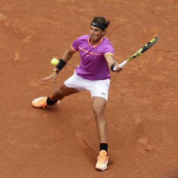 Rafael Nadal of Spain returns a shot to Rogerio Dutra Silva of Brazil during the Barcelona Open Tennis Tournament in Barcelona, Spain, Wednesday, April 26, 2017. (AP Photo/Manu Fernandez)