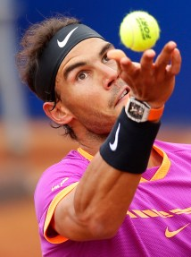 Rafael Nadal of Spain prepares to serve to Dominic Thiem of Austria during their singles final match at the Barcelona Open Tennis Tournament in Barcelona, Spain, Sunday, April 30, 2017. (AP Photo/Manu Fernandez)