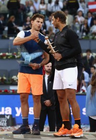 Rafael Nadal of Spain with the winners trophy next to runner up Dominic Thiem of Austria after the final during day nine of the Mutua Madrid Open tennis at La Caja Magica on May 14, 2017 in Madrid, Spain. (May 13, 2017 - Source: Julian Finney/Getty Images Europe)