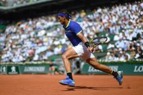 Spain's Rafael Nadal returns the ball to Netherlands' Robin Haase during their tennis match at the Roland Garros 2017 French Open on May 31, 2017 in Paris. / AFP PHOTO / CHRISTOPHE SIMON (May 30, 2017 - Source: AFP)