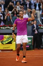 Rafael Nadal of Spain celebrates after winning at match point against Dominic Thiem of Austria in the final during day nine of the Mutua Madrid Open tennis at La Caja Magica on May 14, 2017 in Madrid, Spain. (May 13, 2017 - Source: Julian Finney/Getty Images Europe)