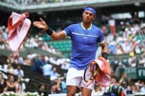 Spain's Rafael Nadal gives a towel back as he plays against Georgia's Nikoloz Basilashvili during their tennis match at the Roland Garros 2017 French Open on June 2, 2017 in Paris. / AFP PHOTO / Lionel Bonaventure (June 1, 2017 - Source: AFP)