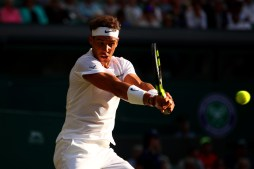 Rafael Nadal of Spain plays a backhand during the Gentlemen's Singles second round match Donald Young of The United States on day three of the Wimbledon Lawn Tennis Championships at the All England Lawn Tennis and Croquet Club on July 5, 2017 in London, England. (July 4, 2017 - Source: Clive Brunskill/Getty Images Europe)