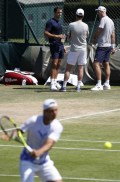 Switzerland's Roger Federer (top L) watches as Spain's Rafael Nadal (foreground) attends a training session at The All England Lawn Tennis Club in Wimbledon, southwest London, on July 5, 2017 on the third day of the 2017 Wimbledon Championships. / AFP PHOTO / Adrian DENNIS / RESTRICTED TO EDITORIAL USE (July 4, 2017 - Source: AFP)