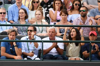 isca Perello (2R) partner of Rafael Nadal of Spain celebrates during his Gentlemen's Singles fourth round match against Gilles Muller of Luxembourg on day seven of the Wimbledon Lawn Tennis Championships at the All England Lawn Tennis and Croquet Club on July 10, 2017 in London, England. (July 9, 2017 - Source: David Ramos/Getty Images Europe)