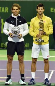 rafael-nadal-and-novak-djokovic-pose-with-their-trophies-after-their-match-in-doha-qatar-final