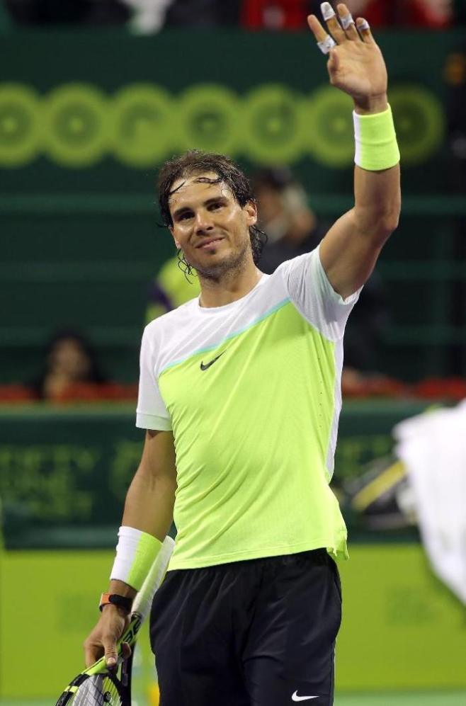 Spanish player Rafael Nadal celebrates after winning match against Illya Marchenko of Ukraine during their semi-final tennis match in the Qatar Open competition on January 8, 2016, in Doha. Nadal won 6-3, 6-4..AFP PHOTO / KARIM JAAFAR