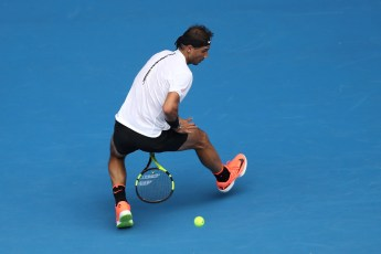 MELBOURNE, AUSTRALIA - JANUARY 17: Rafael Nadal of Spain plays a shot through his legs in his first round match against Florian Mayer of Germany on day two of the 2017 Australian Open at Melbourne Park on January 17, 2017 in Melbourne, Australia. (Photo by Mark Kolbe/Getty Images)