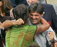 PARIS, France: Spanish Rafael Nadal (L) hugs his coach Toni Nadal after winning against Argentinian Mariano Puerta after their men's final match of the tennis French Open at Roland Garros, 05 June 2005 in Paris. Nadal won 6-7(6) 6-3 6-1 7-5.AFP PHOTO / CHRISTOPHE SIMON (Photo credit should read CHRISTOPHE SIMON/AFP/Getty Images)