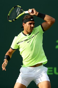 KEY BISCAYNE, FL - MARCH 24: Rafael Nadal of Spain returns a shot to Dudi Sela of Israel during the Miami Open at the Crandon Park Tennis Center on March 24, 2017 in Key Biscayne, Florida. (Photo by Matthew Stockman/Getty Images)