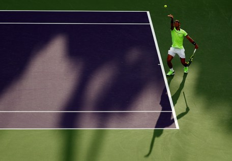 KEY BISCAYNE, FL - MARCH 26: Rafael Nadal of Spain serves against Philipp Kohlscreiber of Germany during Day 7 of the Miami Open at Crandon Park Tennis Center on March 26, 2017 in Key Biscayne, Florida. (Photo by Al Bello/Getty Images)