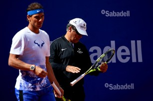 BARCELONA, SPAIN - APRIL 24: Rafael Nadal of Spain and manager Toni Nadal looks on as he trains during the Day 1 of the Barcelona Open Banc Sabadell at the Real Club de Tenis Barcelona on April 24, 2017 in Barcelona, Spain. (Photo by fotopress/Getty Images)
