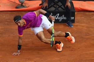 ROME, ITALY - MAY 19: Rafael Nadal of Spain slips during the men's quarter-final match against Dominic Thiem of Austria on Day Six of the Internazionali BNL d'Italia 2017 at Foro Italico on May 19, 2017 in Rome, Italy. (Photo by Michael Steele/Getty Images)