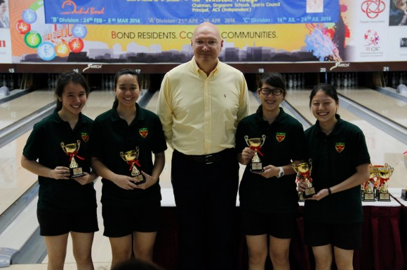 From left to right: Darolyn, Cheritta, Joey and Kristin proudly accept their gold trophies for the team event