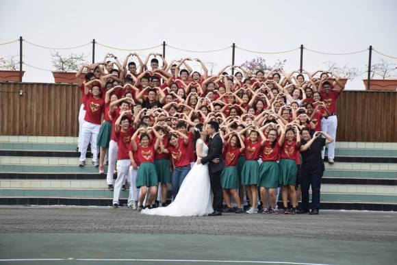 In the middle of our yearbook photoshoot, we became the backdrop for a wedding photo