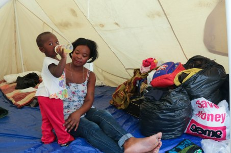 Eva Sitoe fled from her home in Primrose with her daughter to the SANZAF refugee camp in fear of her life. She is from Mozambique says she came to SA to make money and doesn't know whether she is ready to go back to her home country.