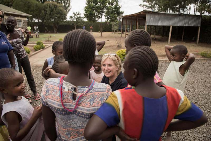 Anne-Marie and some of the small girls from Rafiki Mwema crowding around her listening to her story.