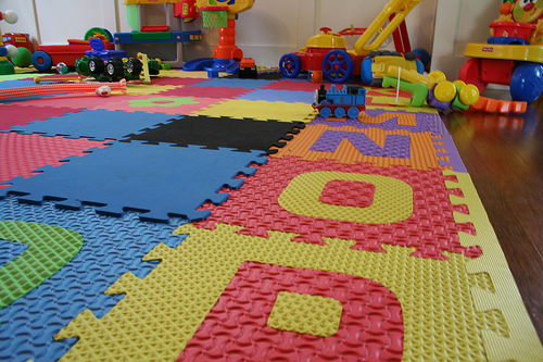 An activity mat is a great way to protect and decorate the flooring in your kids playroom.