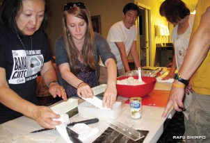 Teeny Miyano, left, and Monica Embrey join Mananar Committee members and volunteers in making Spam musubi at the Dow Villa Motel in Lone Pine, the night before ceremonies.