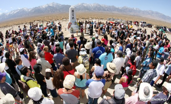 Hundreds surround the memorial in the Manzanar cemetery for an interfaith service on Saturday at the 44th annual Manzanar Pilgrimage.